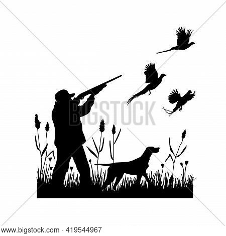 Hunting For Pheasants With A Dog. A Man Shoots A Shotgun At Flying Birds While Standing In The Grass