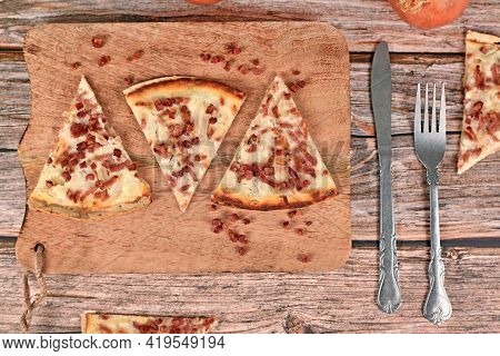 Slices Of Taditional Food 'tarte Flambee' Or 'flammkuchen' From German-french Alsace Border Region.