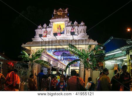 KUALA LUMPUR - JANUARY 26: Hindu devotees come to the Sri Thandayuthapani Temple in Kuala Lumpur, Malaysia to pray to Lord Muruga on January 26, 2013 during the annual Thaipusam festival.