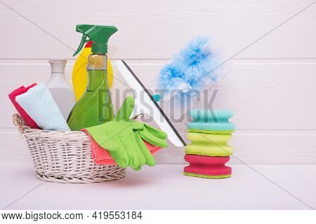 Brushes, Rags, Gloves And Detergents In The Basket, For Cleaning The House On The Table In The Baske