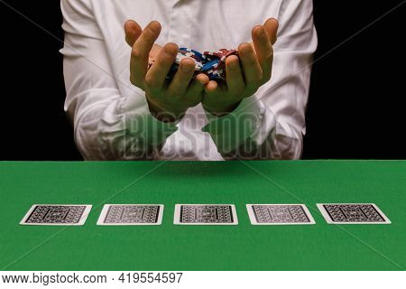 Poker Player In A Casino Or Nightclub With A Lot Of Poker Chips After Becoming A Millionaire And Win