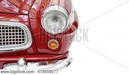 A Front View Of A Red Shiny Vintage Car, Isolated On A White Background. Part Of A Shiny Red Vintage