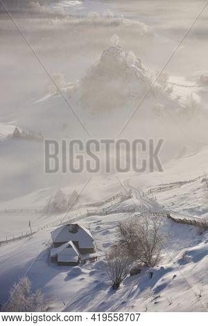 beautiful winter mountain landscape, Fundatura Ponorului, Hunedoara county, Romania - aerial view