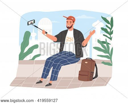 Travel Blogger Speaking To Phone Camera On Selfie Stick For His Lifestyle Vlog. Vlogger Recording Vi