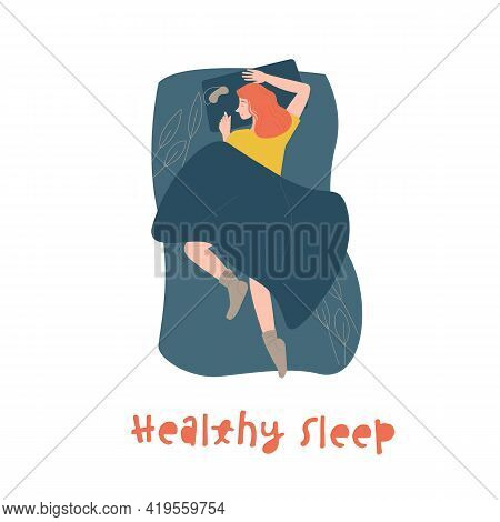 Young Woman Peacefully Sleeping In Her Cozy Bed.