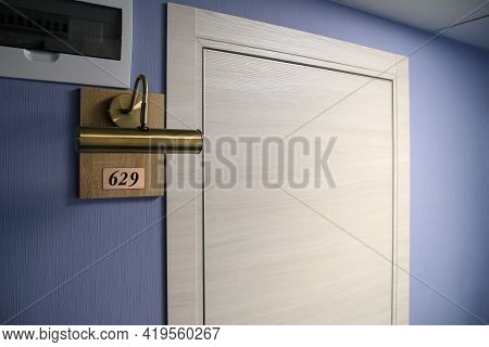 Photo Of The Hotel Room Door. The Lamp Is Directed At The Number Plate. Hotel, Motel, Or Hotel.