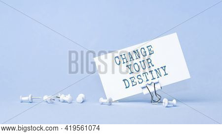 Change Your Destiny - Concept Of Text On Business Card. Closeup Of A Personal Agenda On Blue Backgro