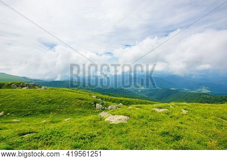 View From Runa Mountain. Huge Stones On The Grassy Slopes. Summer Landscape Of Carpathian Mountains.