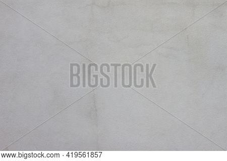 Cement Wall Of The House With Cracks And Stain For Background And Textures.