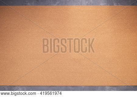 Cork board background texture at concrete floor. Corkboard at wall background with copy space