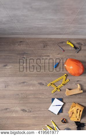 Laminate floor and tools at wood background texture. Wooden laminate floor plank with copy space