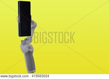 Image Stabilizer Gimbal For Modern Cell Phones. Instrument For Amateur Filming. Image And Video Stab