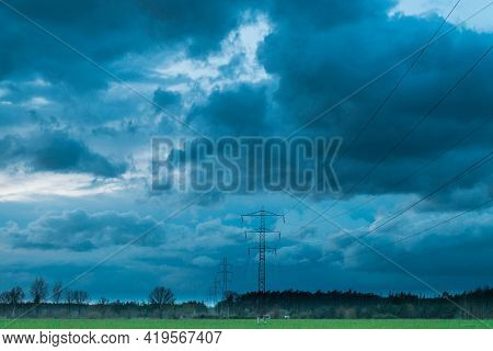 A Vast Plain, Arable Fields And Meadows. It Is Spring In The Fields Growing Young, Green Grain. On T