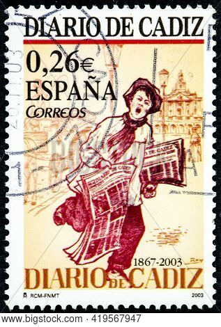Spain - Circa 2003: A Stamp Printed In The Spain Shows A Newspaper Vendor Offering The Cadiz Newspap