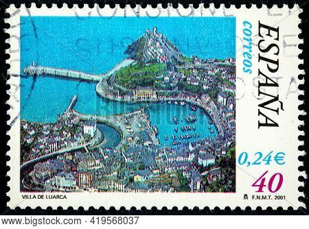 Spain - Circa 2001: A Stamp Printed In The Spain Shows The City Of Luarca In Northern Spain, In The