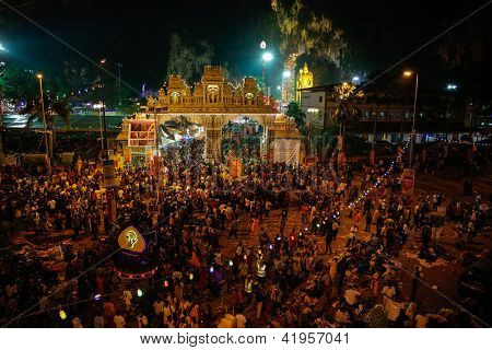 KUALA LUMPUR - JANUARY 27:Hundreds of thousands of Hindu devotees come to the Batu caves temple in Malaysia before sunrise on January 27, 2013 for the annual Thaipusam festival to pray to Lord Muruga.