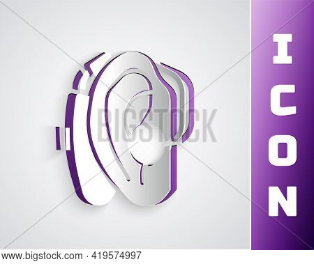 Paper Cut Hearing Aid Icon Isolated On Grey Background. Hearing And Ear. Paper Art Style. Vector