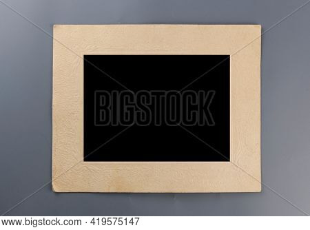 Photo frame - real old photo with black blank space for copy photo or text on gray paper background