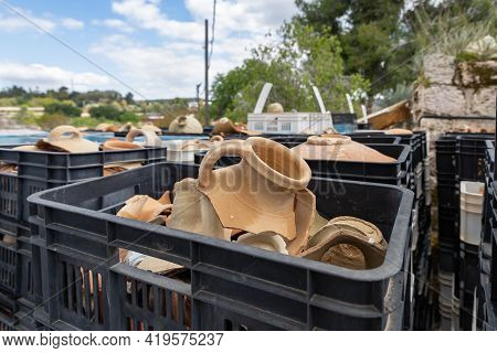 A Large Number Of Plastic Boxes With Fragments Of Pottery And Jugs Near The Excavation In The Ruins