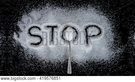 Teaspoon Sugar And Stop Text On Sugar Isolated On Black Background Idea For Reducing The Amount Of S