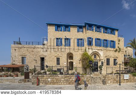 Jaffa, Israel - March 31st, 2021: An Old Stone House, With Typical Mediterranean Blue Shutters, Loca