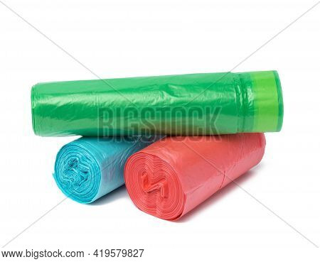 Stack Of Polyethylene Multicolored Disposable Trash Bags On White Background, Close Up