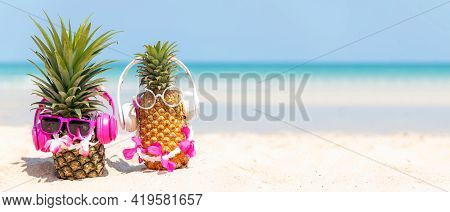 Summer In The Party.  Hipster Pineapple Fashion  Listen Music With Sunblock And Sandal On The Sand B