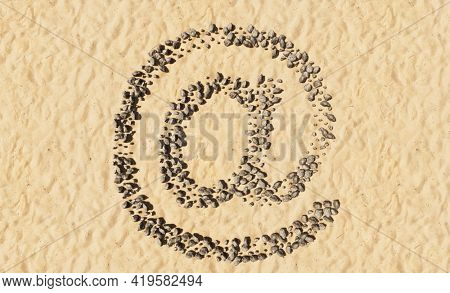 Concept conceptual stones on beach sand handmade symbol shape, golden sandy background, sign of at sign. 3d illustration metaphor for education, nature, sunny and tropical, summer, sunny, seaside