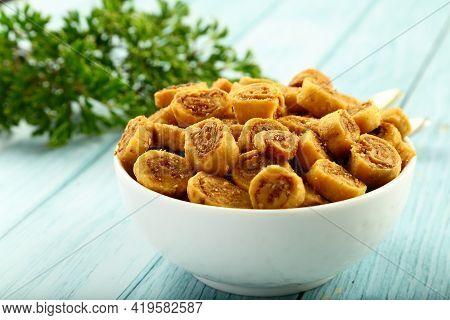 Indian Street Foods Background- Savory Snack- Bakarwadi.