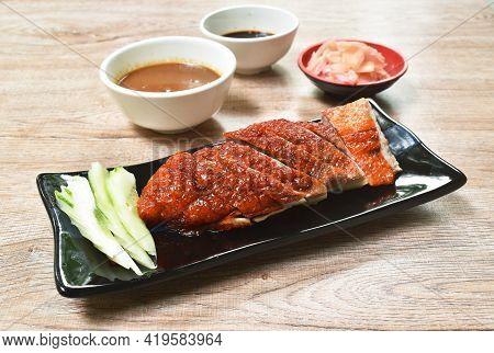 Roasted Duck Meat And Pickled Ginger Dipping Sweet Soy Sauce On Plate