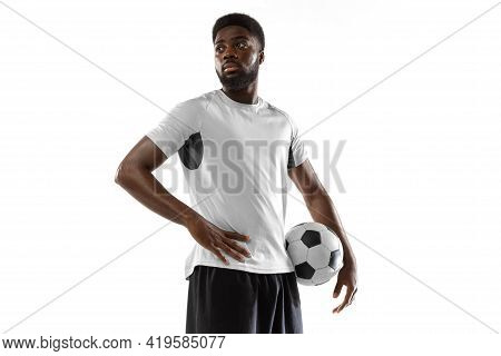 Close-up Young African Soccer Player Posing Isolated On White Background. Concept Of Sport.