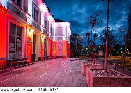 Pruszcz Gdanski, Poland - May 3, 2021: Red and white illumination at the Constitution Day on May 3 on the  City Hall building in Pruszcz Gda?ski. Poland