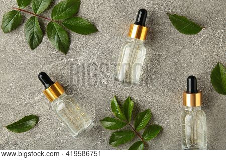 Natural Skincare Bottles Container And Organic Green Leaf , Flowers Ingredients With The Laboratory