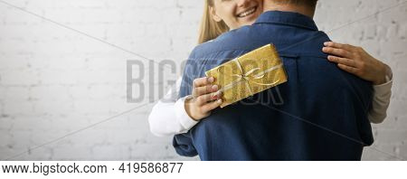 Happy Smiling Wife Hugging Husband After Receiving Present. Birthday Or Anniversary Surprise. Copy S