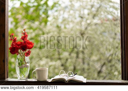 Book, Glasses, Cup Of Tea And Red Tulips On A Wooden Window. Read And Rest.