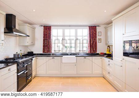 Shaker Style Farmhouse Kitchen With Neutral Painted Wood Modular Units, Uk Kitchen Interior Design