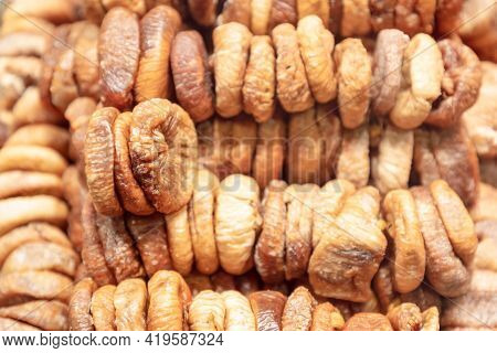 Dried Figs In Stacks For Background (selective Focus)