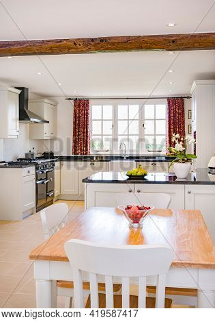 Farmhouse Kitchen Furniture Design. Uk Open Plan Farmhouse Kitchen Interior With Modern Painted Wood