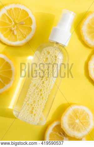 Antiseptic And Lemons On A Yellow Background . Antiseptic For Hands. Health And Medicine