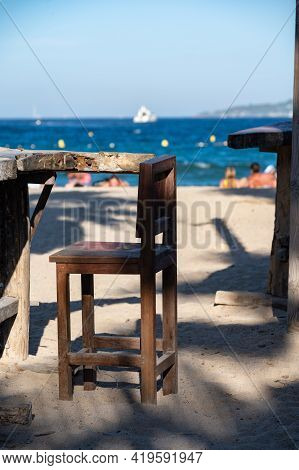 Empty Beach Cafe With View On Blue Water Of Gulf Of Saint-tropez, French Riviera, France