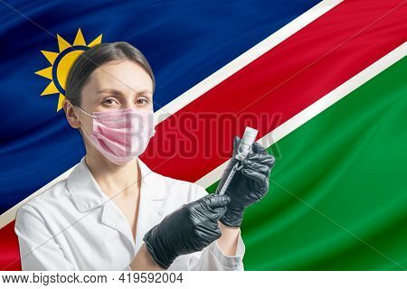 Girl Doctor Prepares Vaccination Against The Background Of The Namibia Flag. Vaccination Concept Nam