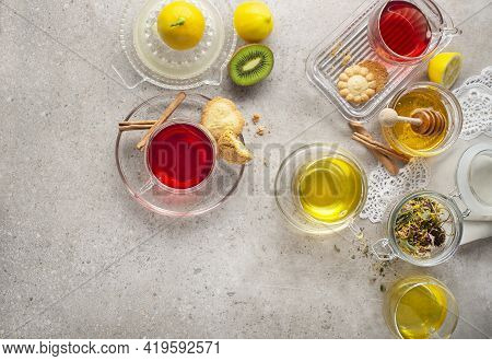 Herbal Tea, Green Tea, Fruit Tea Cups On Grey Background