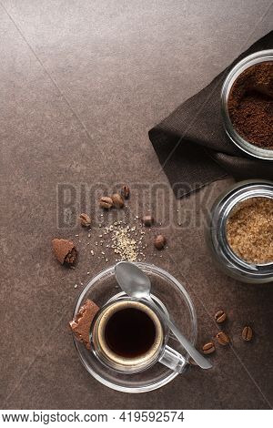 Cup Of Espresso Coffee With Ingredients On Dark Table