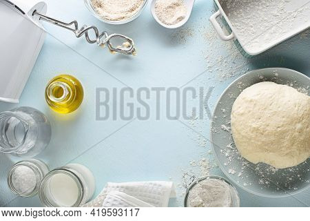 Ingredients For Making And Baking Homemade Bread On Blue Table Background. Mixing And Kneading The D