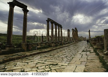 The Colonnade Of The Decumanus Maximus In The Ancient Roman City Of Jerash. High Quality Photo