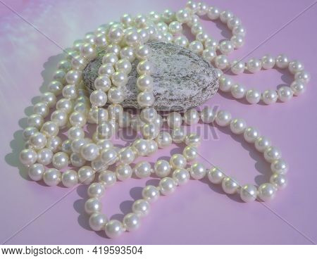 Pearls Of White Color Close-up. Pendants On The Neck. Close Up Natural White Pearl Necklace In The S