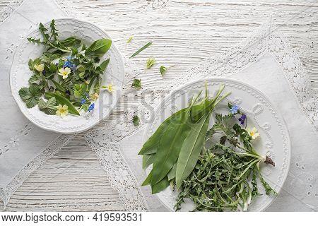 Healthy Spring Plants Food Ingredients. Dandelion, Wild Garlic, Flowers And Nettle On Plate