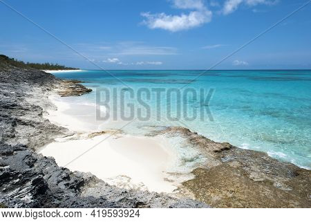The Scenic View Of Half Moon Cay Island Rocky Coastline With Turquoise Color Transparent Waters (bah