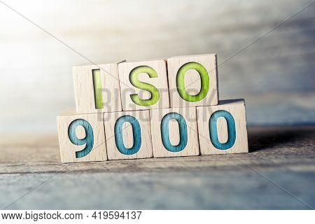Iso 9000 Written On Wooden Blocks On A Board