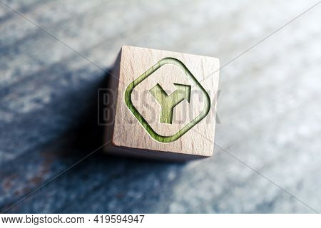 Crossroad And Decision Sign Written On Wooden Blocks On A Board